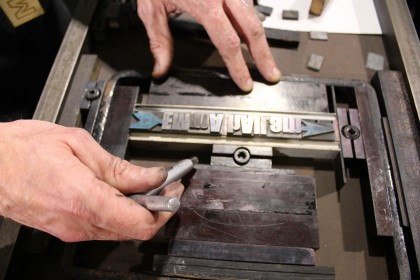 Visitors try letter press