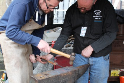 Traditional blacksmithing takes place outside