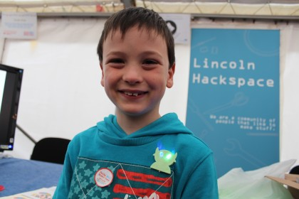 A young maker with his badge at Derby Mini MAker Faire 2015